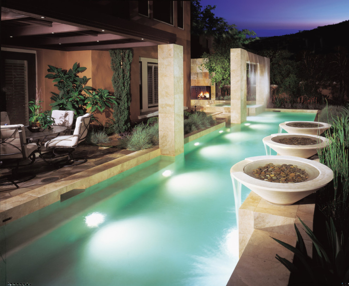A narrow passage like swimming pool with mint blue colour of the pool looks sweet