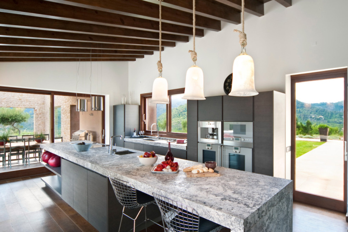 White-and-grey-modern-Kitchen-with-a-long-panel-of-granite-rust-top-kitchen-table-idea