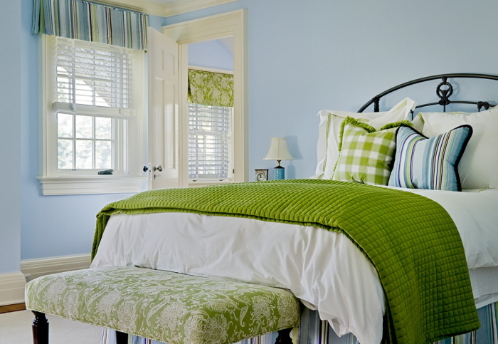 A-bed-room-with-lime-green-feel-its-cushion-blanket-and-the-cute-bench