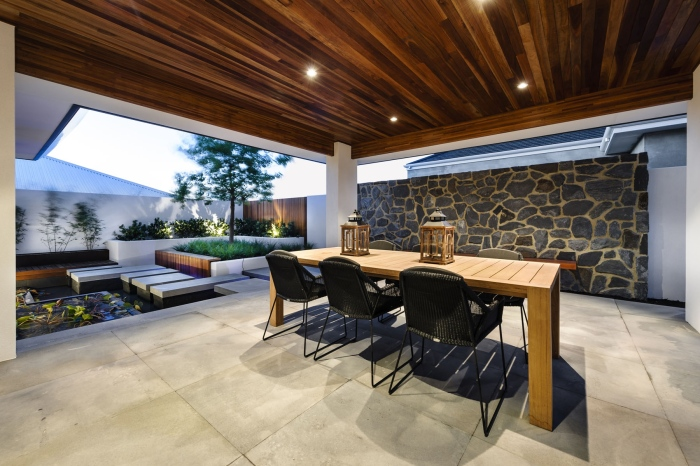 Traditional-dining-area-with-Japanese-art- rocky-accent-wall