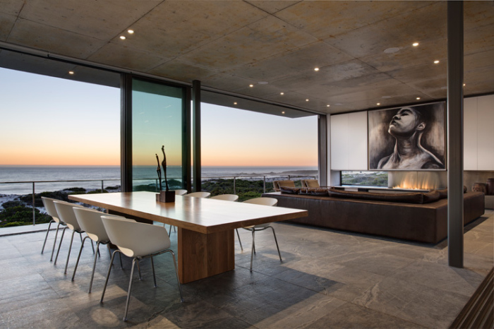 A-dining-and-living-area-with-a-modern-painting-hung-on-the-wall