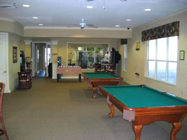 two pool tables and space