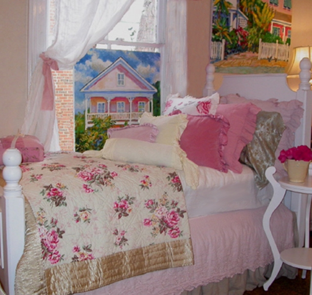 pink and blue cushions with pink roses