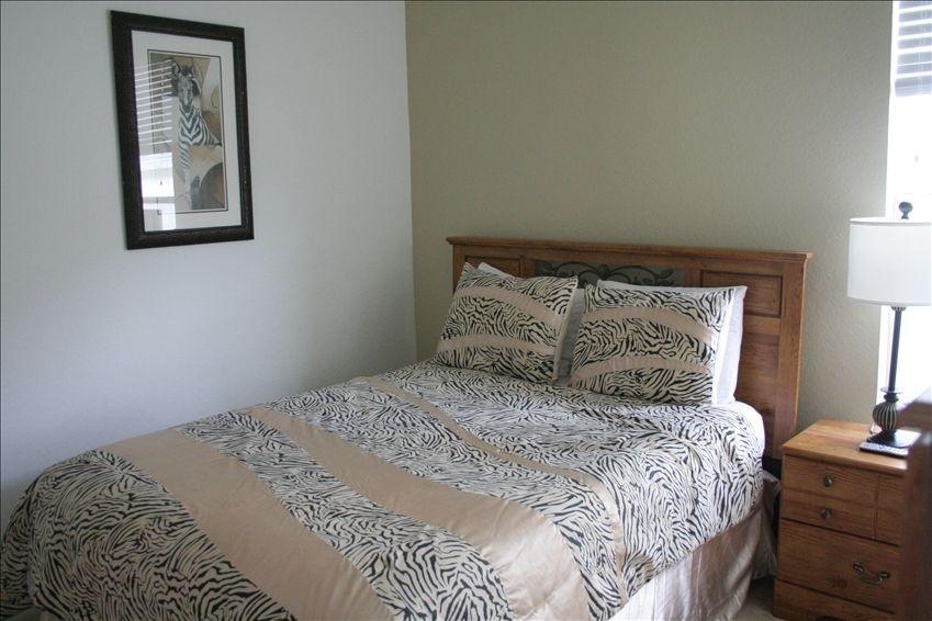 beige and black zebra print bedding