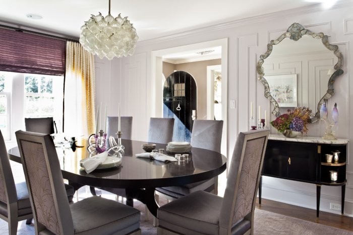 Petal shaped white lights in a cluster make up a chandelier above the dining table