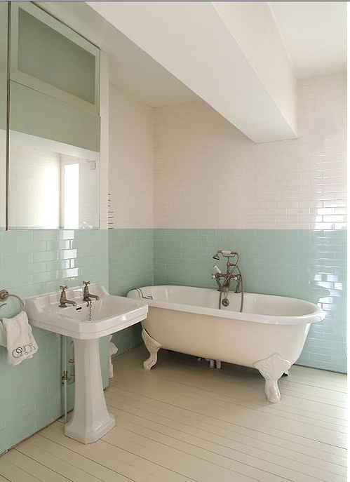 A pair of white subway tiles with a pastel light powder blue color