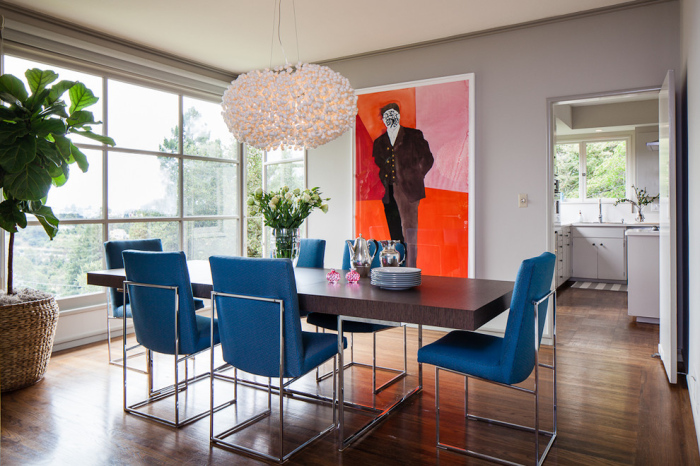 A modern portrait of a man with coloured panels makes the dining room quite bright