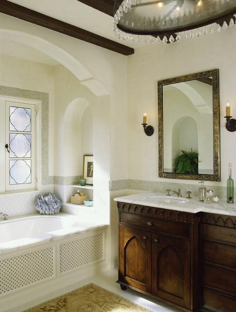 There is a stunning vanity with drop-in sink and sleek countertop