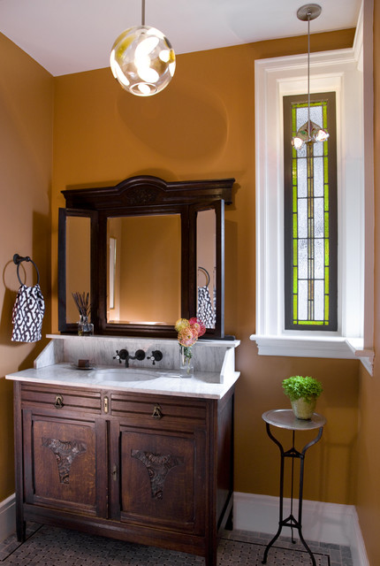 The vanity is a beautiful antique with marble counter top