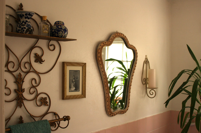 There is a unique mirror with wooden frame