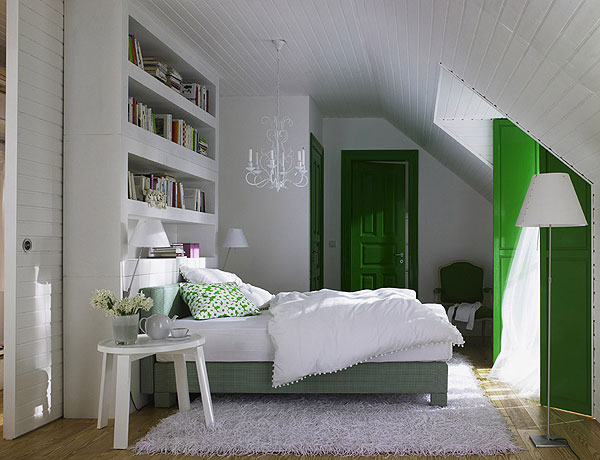 bedroom with bookshelves placed above the headboard