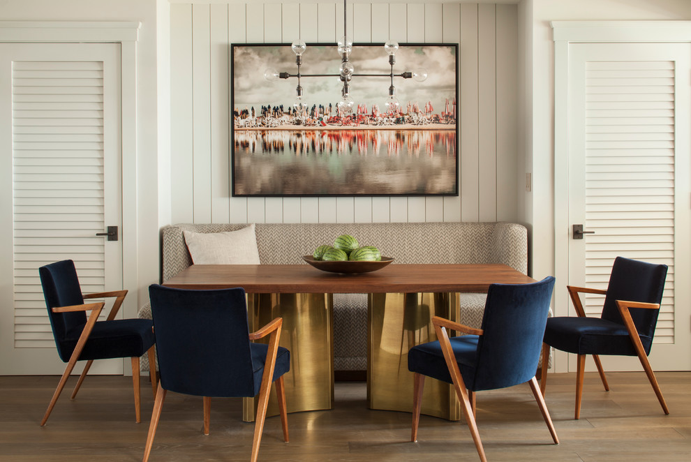 three blue dining chairs