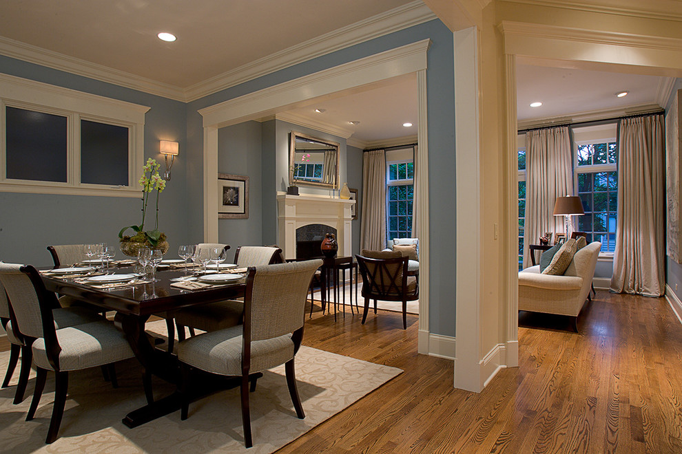 pale blue and white colour of the walls with wooden flooring tables