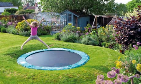 Garden and children play area with a sunken trampoline