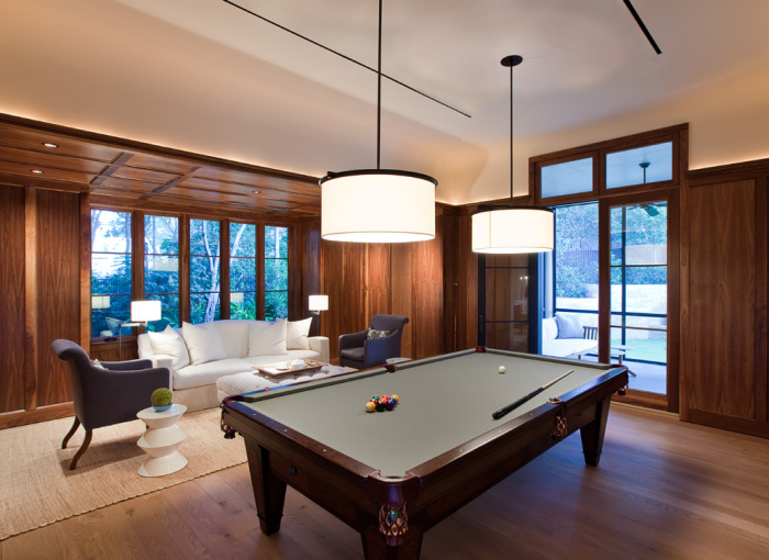 The pool table is  is kept in the side of the living room