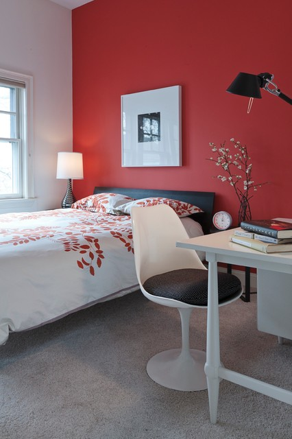 The smooth red paint on the wall creates romantic and passionate mood