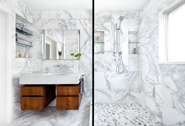 Unique vanity and cabinet design compliment this bathroom well