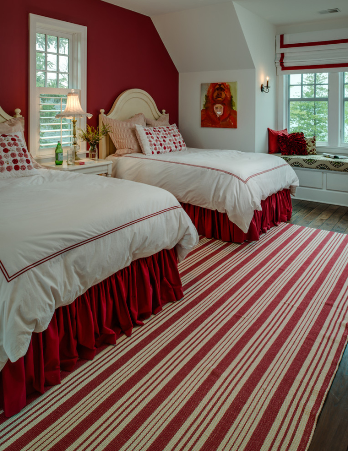 The rug features strips of red and white