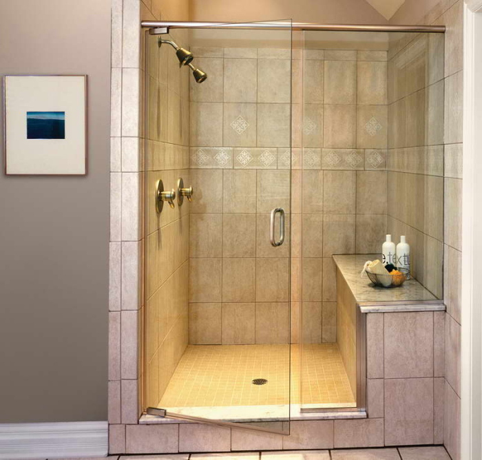 This Quaker-rose colored walk-in shower will add a soothing effect to a room
