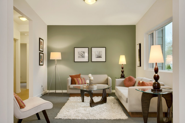 This living room is perked up as the accent wall is given a green touch