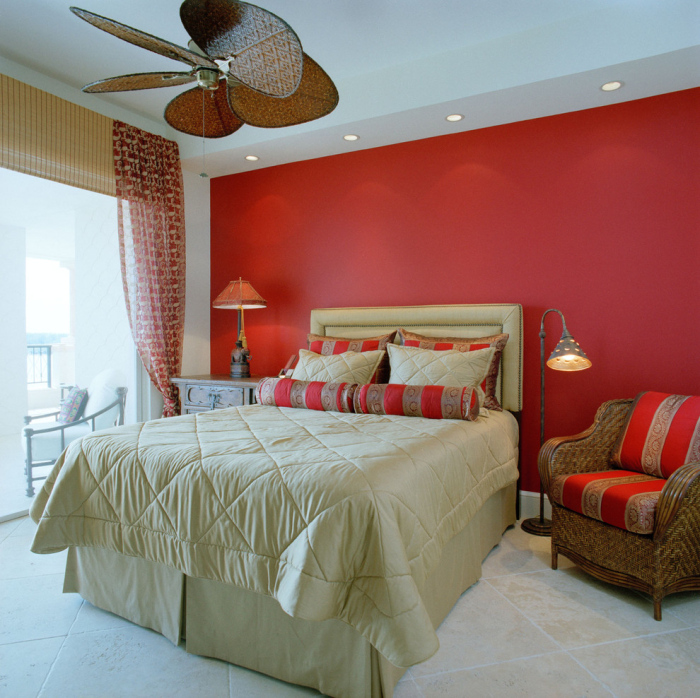 This room has a tropical look to itself with a bright red highlighted wall