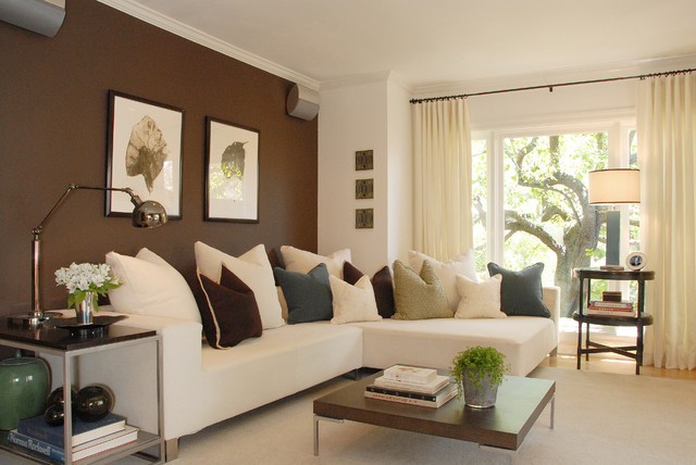 The brown accent wall creates a livelier impact in this living room