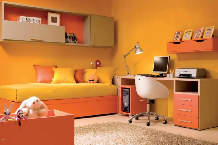 The bright yellow wall paint makes the room colorful and alive
