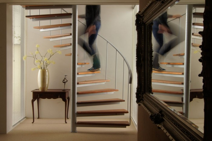 staircase is in an arc with mirror