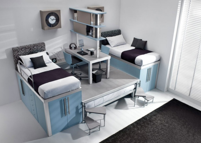 stylish twin bedroom interior for teenage boys with a shared work place