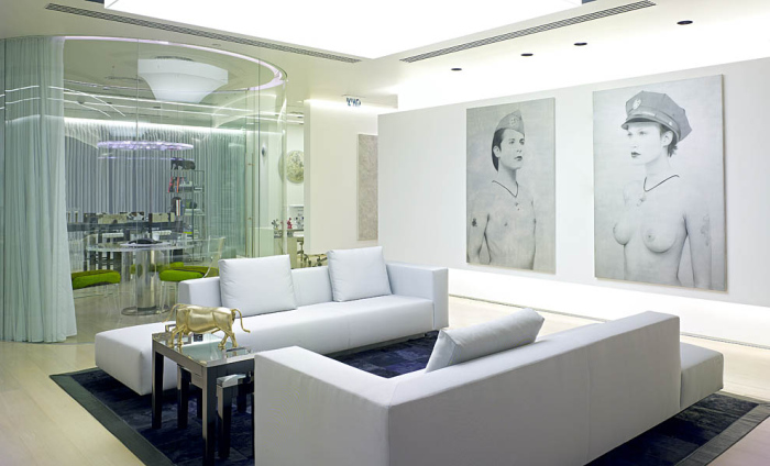 Sitting area with two art decor human pictures on the wall