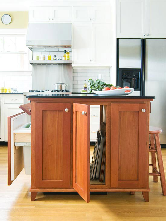 compact cherry island provides work space and cabinetry