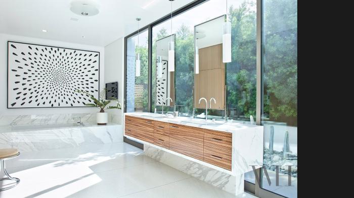 Bathroom with white marbled bathtub