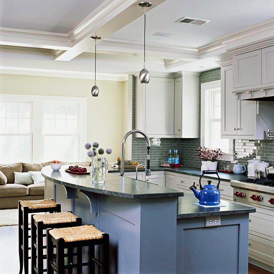 slate blue paint on the island's base and the white cabinetry