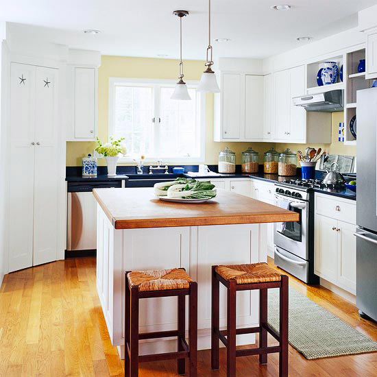 Color of the island matches with cabinets in this kitchen