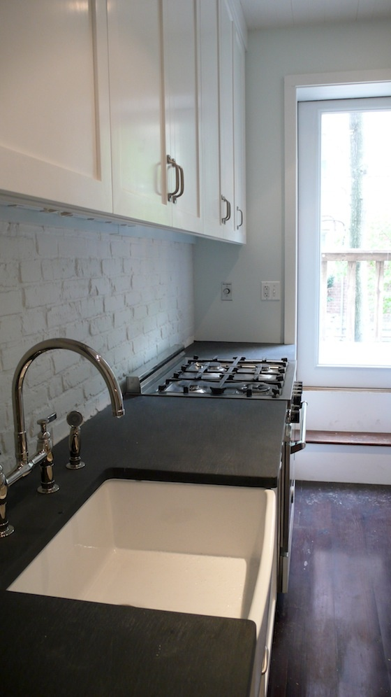 slate counter top with a farmhouse sink, this simple kitchen design