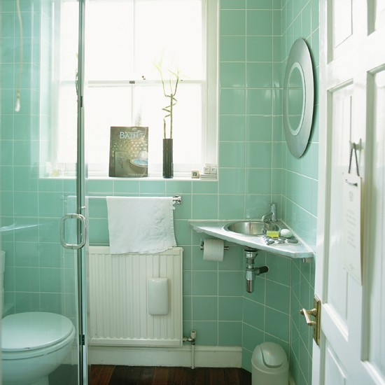 small shower design with light green wall tiles