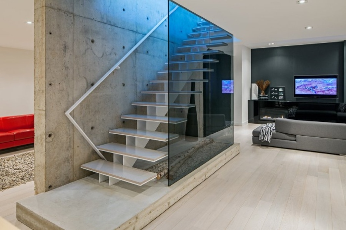 The staircase makes this part of the home look very lavish