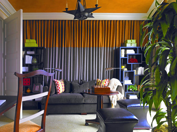 The entire black wall is draped in an orange and grey fabric
