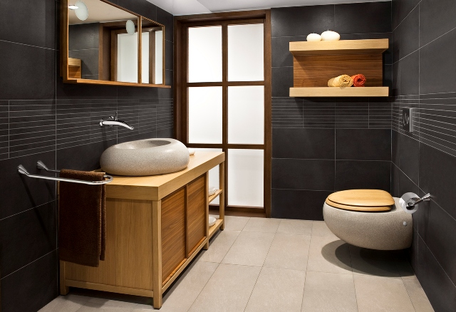 Dark wooden bathroom with  unique sink and toilet bowl