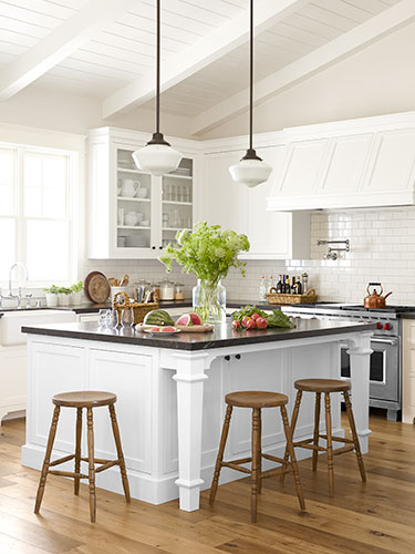 Kitchen island with wooden stools set on the sides