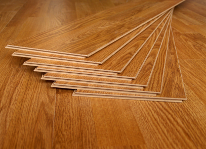 Laminate flooring doesn't exactly feel like wood or tiles