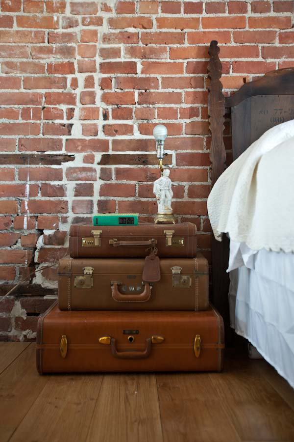 suitcases and stack them to form a pyramid shape