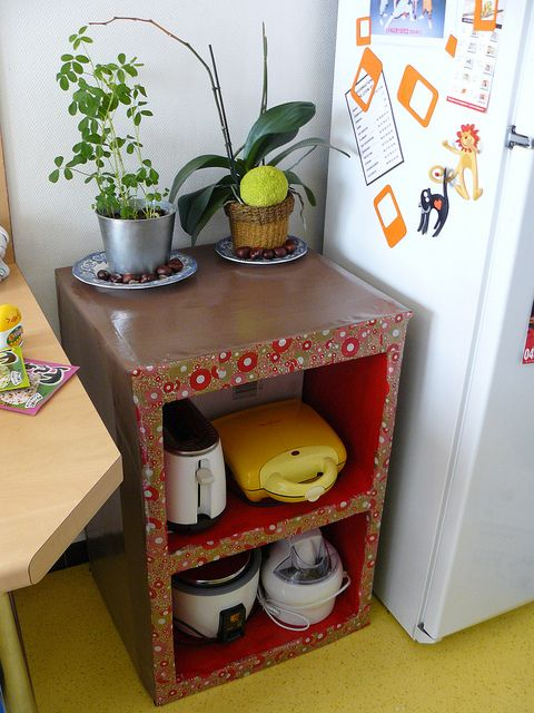 Cardboard little cabinet with decors on it