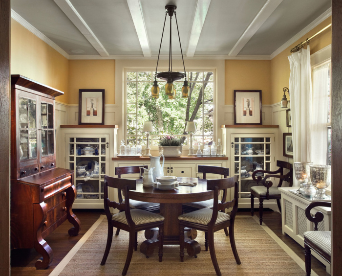 Dining room with a dark wood storage cabinet