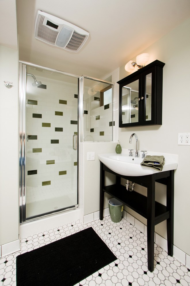 Fabulous and stylish bathroom with varying patterns of floor and wall tiles
