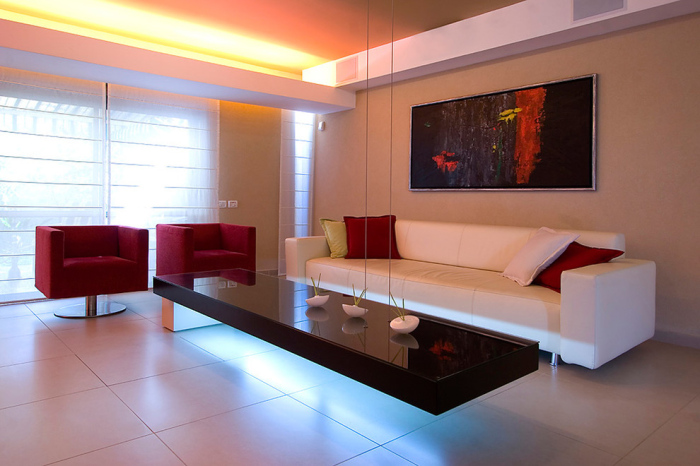 Contemporary living room with long elated table
