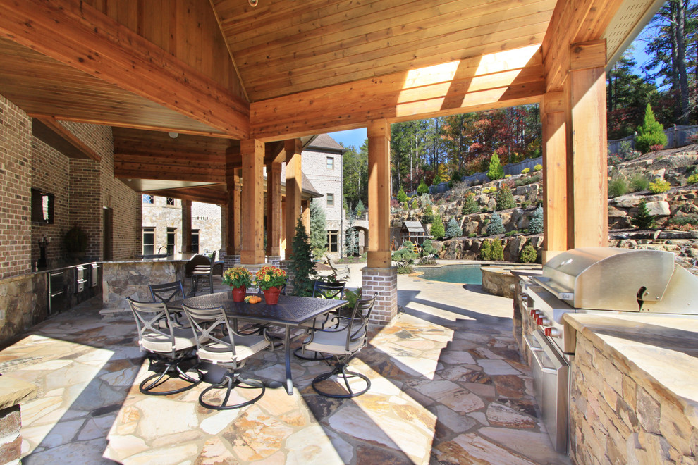 10 custom outdoor kitchen designs for Outdoor kitchen and dining