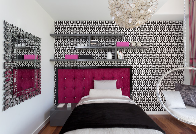 Bedroom with black printed wallpaper