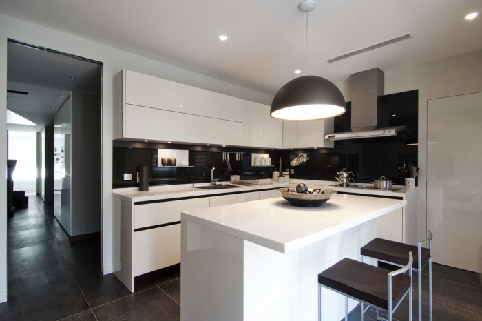 Sleek granite black wall tiles kitchen back-splash