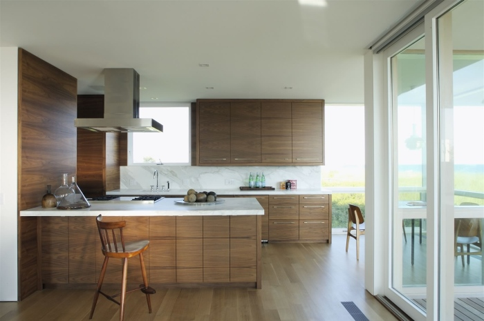 wooden chair totally complements the kitchen area